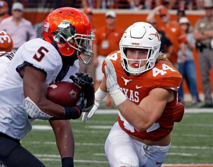 In this Oct. 21, 2017, file photo, Texas linebacker Breckyn Hager (44) pursues Oklahoma State running back Justice Hill (5) during the first half of an NCAA college football game in Austin, Texas.