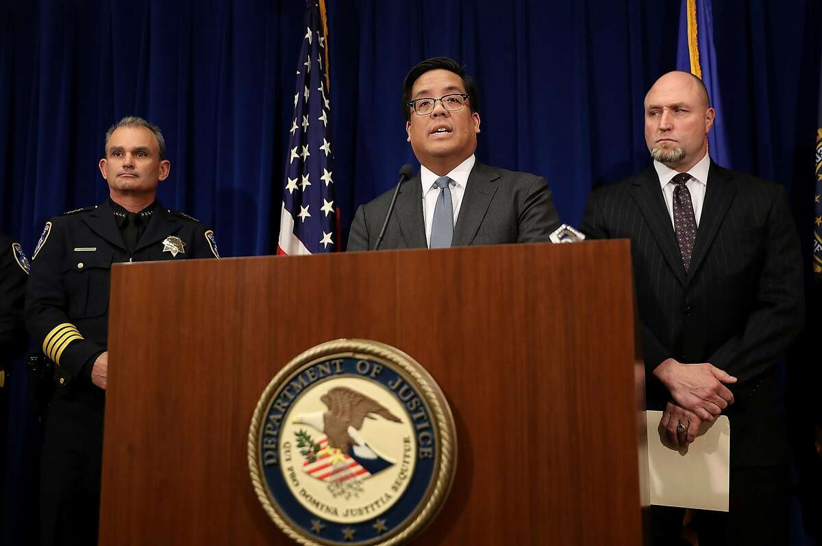 SAN FRANCISCO, CA - NOVEMBER 20: First Assistant United States Attorney Alex Tse (C) speaks during a news conference on November 20, 2017 in San Francisco, California. The United States Attorney's office and the Federal Bureau of Investigation announced that a federal grand jury has indicted 9 associates of the Hells Angels Sonoma County chapter with charges of murder, racketeering and conspiracy. (Photo by Justin Sullivan/Getty Images)
