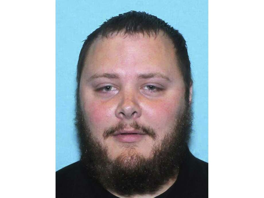 FILE - This undated file photo provided by the Texas Department of Public Safety shows Devin Kelley, the suspect in the shooting at First Baptist Church in Sutherland Springs, Texas, on Sunday, Nov. 5, 2017. A short time after the shooting, Kelley was found dead in his vehicle. Federal investigators say they are trying to get into Kelley's cellphone. The inability to access Kelley's phone highlights a longstanding frustration of the FBI, which said it has been unable to retrieve data from half the mobile devices it tried to access in less than a year. Technology companies have insisted they must protect customers' digital privacy. (Texas Department of Public Safety via AP, File) Photo: Associated Press / Texas Department of Public Safety