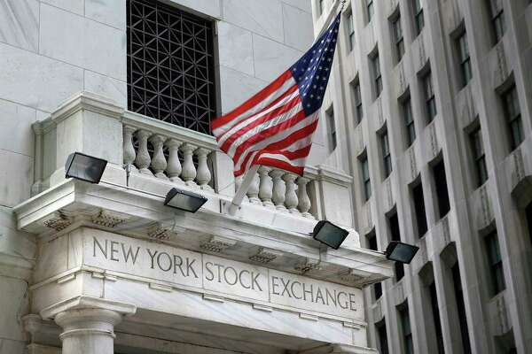 FILE - This Monday, Aug. 24, 2015, file photo shows the New York Stock Exchange. U.S. stocks are opening slightly higher, Monday, Nov. 20, 2017, as technology companies and retailers make gains.(AP Photo/Seth Wenig, File)