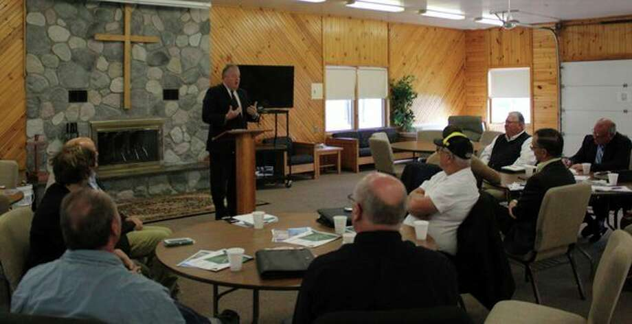 Huron County Circuit Court Judge Gerald M. Prill speaks Monday to county commissioners from throughout the region about the severity of the opioid crisis at Bay Shore Camp in Sebewaing.
