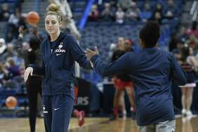 UConn's Katie Lou Samuelson, left, will sit out Tuesday's game against UCLA with a foot injurey.