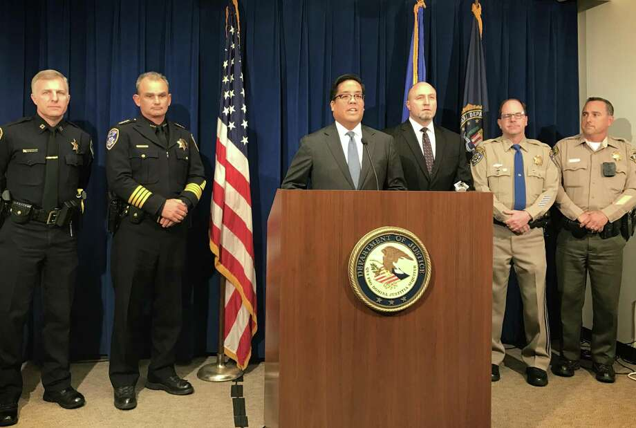 Assistant U.S. Attorney Alex Tse announces a federal racketeering indictment against members of the Hells Angels Sonoma County chapter on Monday. Photo: Evan Sernoffsky / The Chronicle / /
