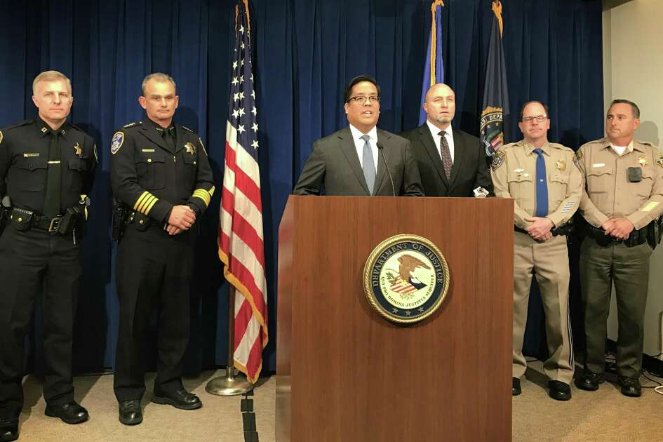 Assistant U.S. Attorney Alex Tse announces a federal racketeering indictment against members of the Hells Angels Sonoma County chapter on Monday.