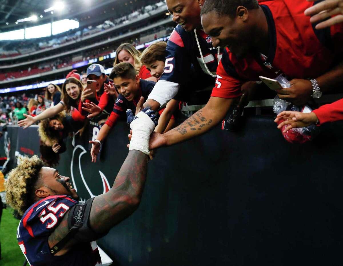 Houston Texans inside linebacker Benardrick McKinney (55) high fives fans as he leaves the field following the Texans 31-21 win over the Arizona Cardinals in an NFL game at NRG Stadium on Sunday, Nov. 19, 2017, in Houston. ( Brett Coomer / Houston Chronicle )