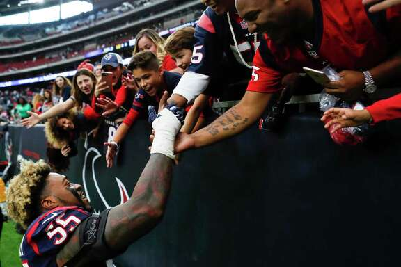 Houston Texans inside linebacker Benardrick McKinney (55) high fives fans as he leaves the field following the Texans 31-21 win over the Arizona Cardinals in an NFL game at NRG Stadium on Sunday, Nov. 19, 2017, in Houston. ( Brett Coomer / Houston Chronicle )