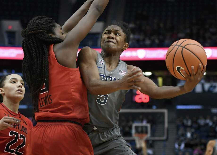 UConn's Crystal Dangerfield, right, shoots around Maryland's Channise Lewis on Sunday. Photo: Jessica Hill / Associated Press / AP2017