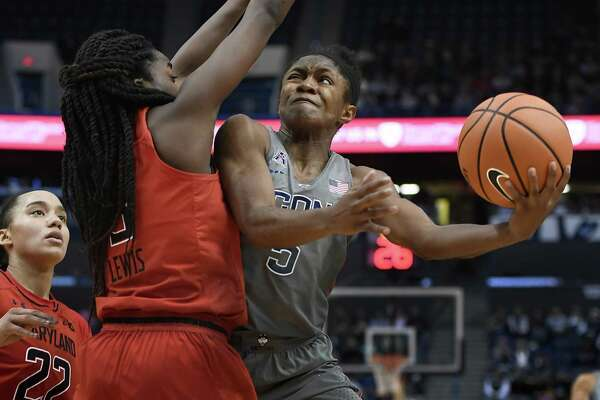 UConn's Crystal Dangerfield, right, shoots around Maryland's Channise Lewis on Sunday.