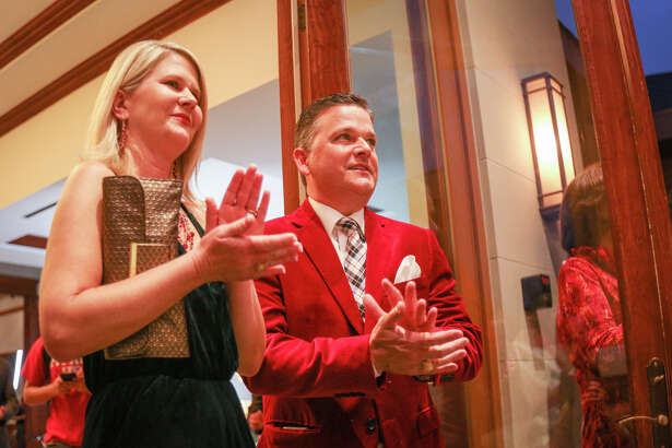 Precinct 3 Commissioner James Noack and his wife Lori applaud during the Toys for Tots event on Tuesday, Nov. 29, 2016, at The Woodlands Country Club Palmer Course.