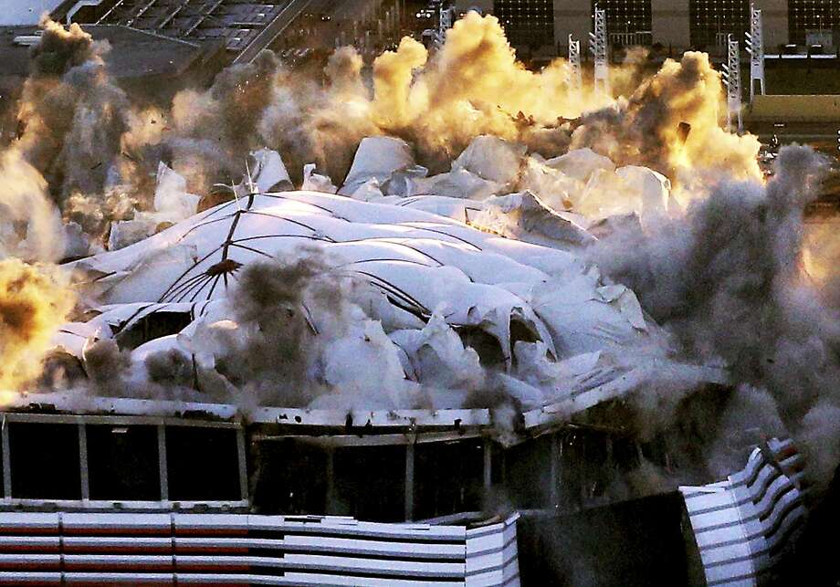 The Georgia Dome is destroyed in a scheduled implosion Monday, Nov. 20, 2017, in Atlanta. The dome was not only the former home of the Atlanta Falcons but also the site of two Super Bowls, 1996 Olympic Games events and NCAA basketball tournaments among other major events. (Curtis Compton/Atlanta Journal-Constitution via AP) Photo: Curtis Compton, Associated Press