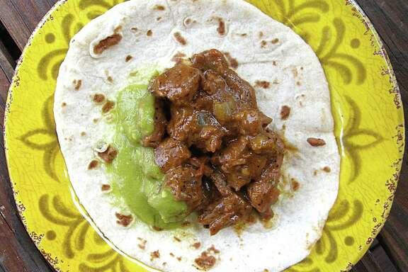 Carne guisada taco on a handmade flour tortilla from Papa Nono's Mexican Grill.