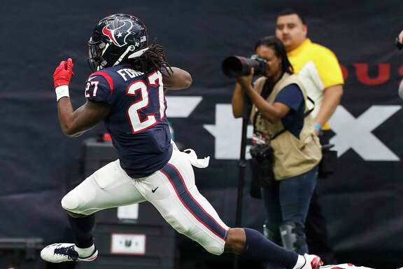 Houston Texans running back D'Onta Foreman (27) breaks away from Arizona Cardinals strong safety Antoine Bethea (41) on his way to a 34-yard touchdown run during the fourth quarter of an NFL game at NRG Stadium on Sunday, Nov. 19, 2017, in Houston. ( Brett Coomer / Houston Chronicle )