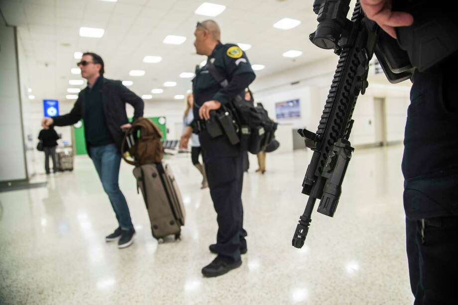 Houston Police Department officers walk the George Bush Intercontinental Airport carrying AR-15 rifles, Monday, Nov. 20, 2017, in Houston. They say the travelers have all given positive feedback. ( Marie D. De Jesus / Houston Chronicle ) Photo: Marie D. De Jesus, Houston Chronicle / © 2017 Houston Chronicle