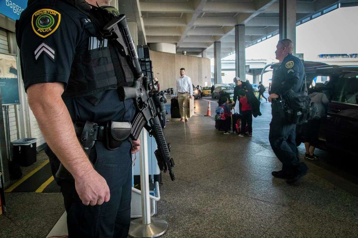 Houston Police Department officers keep an on on the departures section of the Terminal A of the George Bush Intercontinental Airport carrying AR-15 rifles, Monday, Nov. 20, 2017, in Houston. ( Marie D. De Jesus / Houston Chronicle )