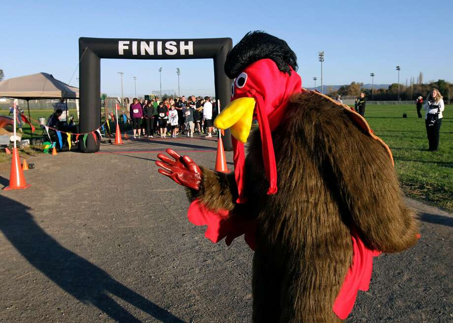 """Dressed as """"Turkey Trotter"""", Al Ojo motivates participants on the starting line of the first annual Napa Valley Turkey Trot 5K run in Napa, Calif. on Saturday, Nov. 23, 2013. Photo: Paul Chinn, The Chronicle"""