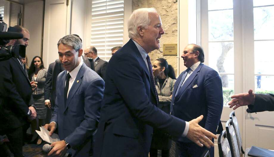 """U.S. Sen. John Cornyn (right, hand extended) arrives Monday November 20, 2017 at the San Antonio Marriott Plaza Center Hotel for the NAFTA field hearing on the 24th anniversary of the Senate's approval of the pact. Behind Cornyn is San Antonio Mayor Ron Nirenberg. Panels of witnesses spoke at the meeting to voice their views on the modernization of the North American Free Trade Agreement (NAFTA) while negotiators for the revised """"NAFTA 2.0"""" are in Mexico City for talks. Photo: John Davenport /San Antonio Express-News / ©John Davenport/San Antonio Express-News"""