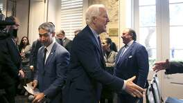 "U.S. Sen. John Cornyn (right, hand extended) arrives Monday November 20, 2017 at the San Antonio Marriott Plaza Center Hotel for the NAFTA field hearing on the 24th anniversary of the Senate's approval of the pact. Behind Cornyn is San Antonio Mayor Ron Nirenberg. Panels of witnesses spoke at the meeting to voice their views on the modernization of the North American Free Trade Agreement (NAFTA) while negotiators for the revised ""NAFTA 2.0"" are in Mexico City for talks."