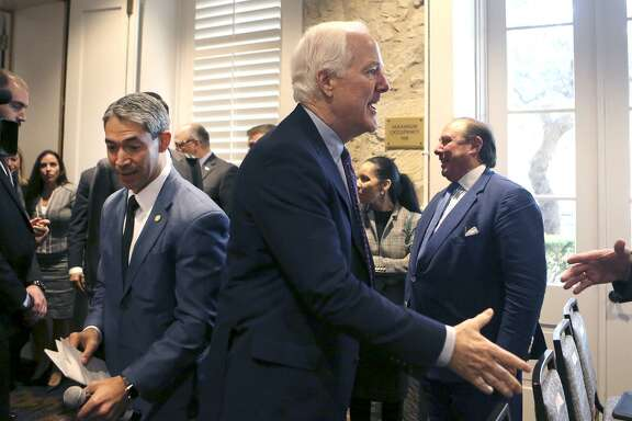"""U.S. Sen. John Cornyn (right, hand extended) arrives Monday November 20, 2017 at the San Antonio Marriott Plaza Center Hotel for the NAFTA field hearing on the 24th anniversary of the Senate's approval of the pact. Behind Cornyn is San Antonio Mayor Ron Nirenberg. Panels of witnesses spoke at the meeting to voice their views on the modernization of the North American Free Trade Agreement (NAFTA) while negotiators for the revised """"NAFTA 2.0"""" are in Mexico City for talks."""