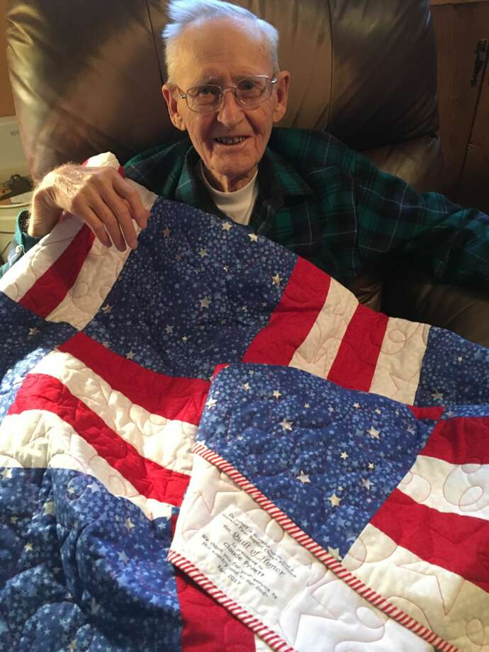Claude Pruett with his quilt made by Barbt Lambert, a member of First Baptist Church Photo: Courtesy Photo