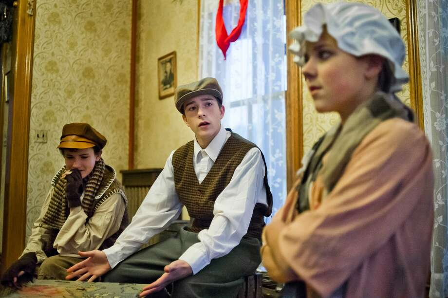 From left, Dixon Anderson, in the role of Evan Thompson, Andersen Griffin-Strand, in the role of Malcolm Thompson, and Hailey Allen, in the role of Clara Johnson, act out a scene during a dress rehearsal for Center Stage Theatre's production of The Brethren, written and directed by Jeff Simmons, on Monday, Nov. 20, 2017 at the Bradley Home Museum. Performance dates are Nov. 24, 25 and 26 at 2 p.m. and 5 p.m. (Katy Kildee/kkildee@mdn.net) Photo: (Katy Kildee/kkildee@mdn.net)