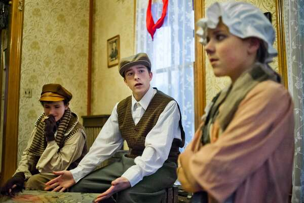 From left, Dixon Anderson, in the role of Evan Thompson, Andersen Griffin-Strand, in the role of Malcolm Thompson, and Hailey Allen, in the role of Clara Johnson, act out a scene during a dress rehearsal for Center Stage Theatre's production of The Brethren, written and directed by Jeff Simmons, on Monday, Nov. 20, 2017 at the Bradley Home Museum. Performance dates are Nov. 24, 25 and 26 at 2 p.m. and 5 p.m. (Katy Kildee/kkildee@mdn.net)