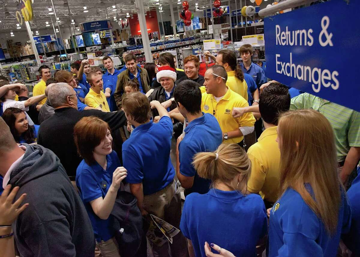 Employees get fired up before the store opens during the traditional Black Friday shopping day at Best Buy in The Woodlands on Friday.