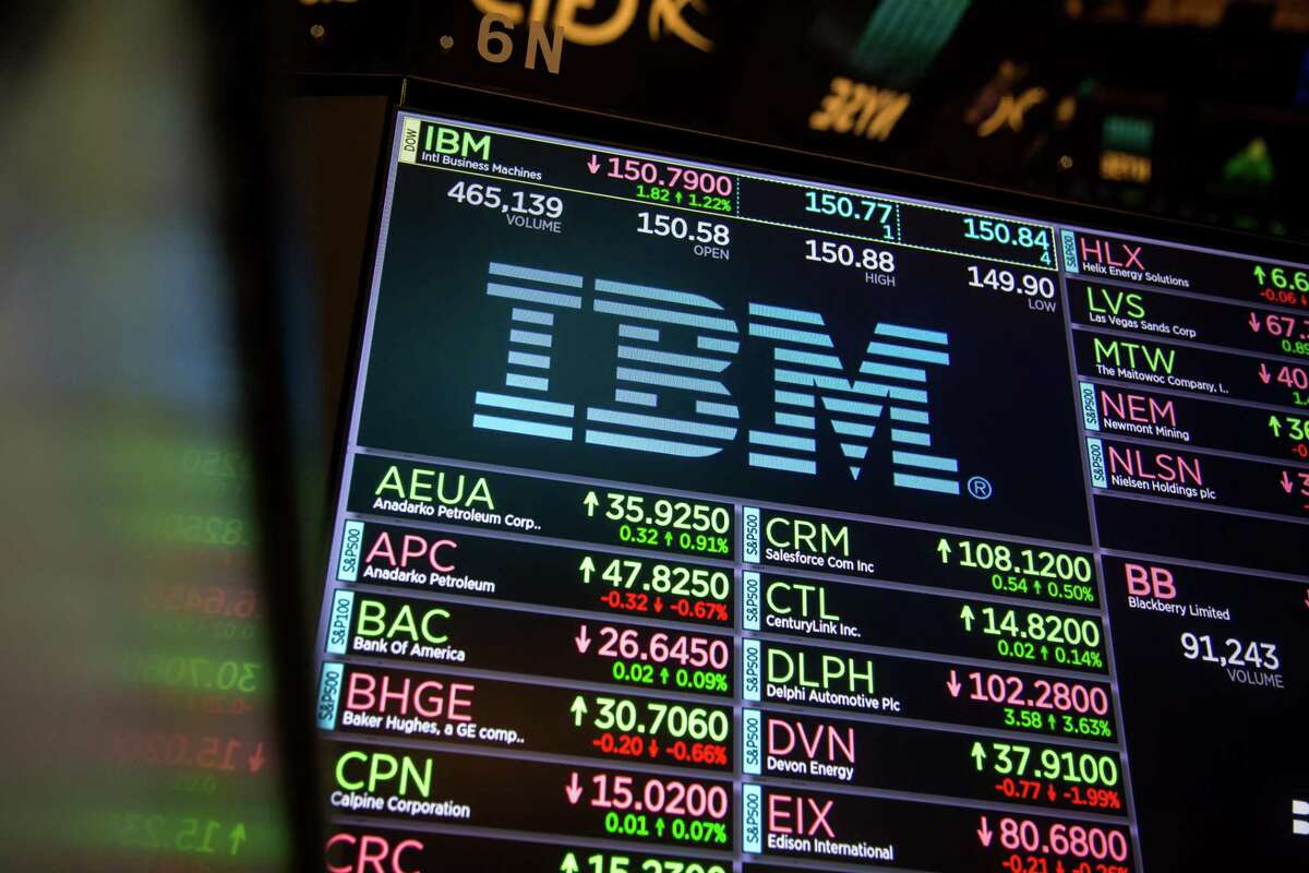 A monitor displays International Business Machines Corp. (IBM) signage on the floor of the New York Stock Exchange (NYSE) in New York, U.S., on Monday, Nov. 20, 2017. The main U.S. equity gauge moved just a 10th of a percent last week, but investor hedging has jumped to a six-year high. Photographer: Michael Nagle/Bloomberg ORG XMIT: 775081187