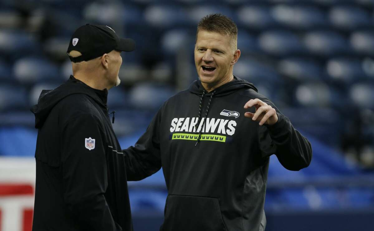 Atlanta Falcons head coach Dan Quinn, left, talks with Seattle Seahawks offensive coordinator Darrell Bevell before an NFL football game, Monday, Nov. 20, 2017, in Seattle.