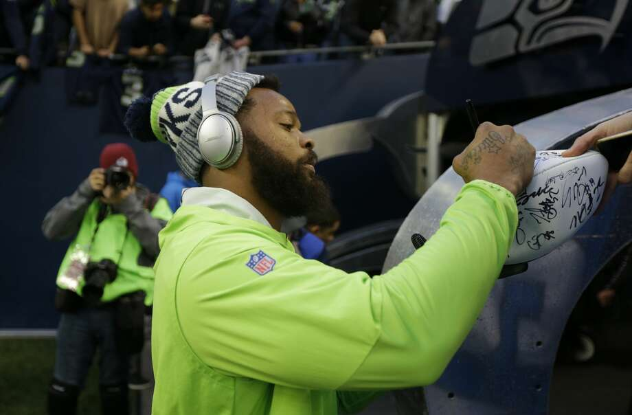 Seattle Seahawks' Michael Bennett signs autographs before an NFL football game, Monday, Nov. 20, 2017, in Seattle. (AP Photo/Ted S. Warren) Photo: Ted S. Warren/AP