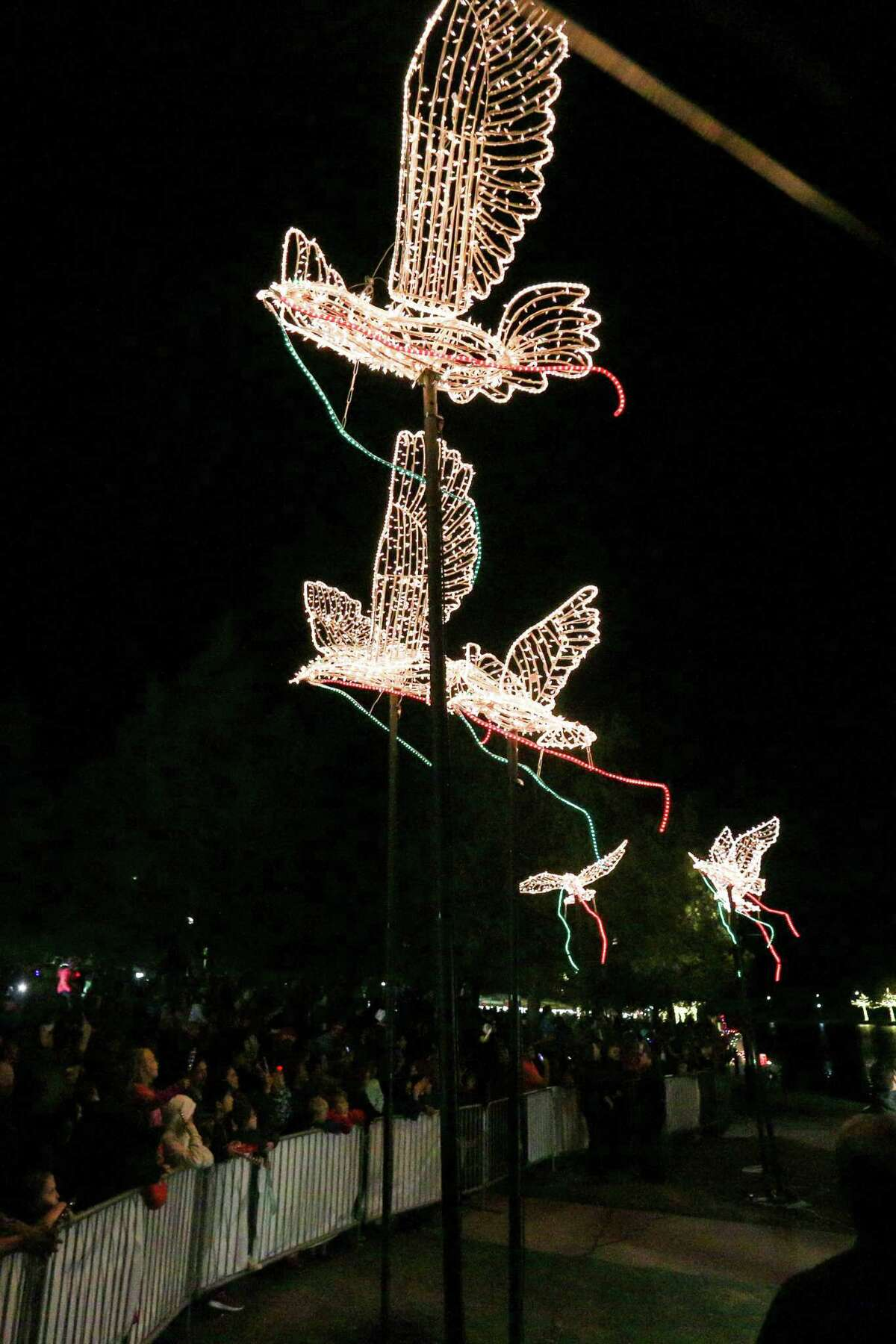 Several dove sculptures burst to light during the Lighting of the Doves event on Saturday, Nov. 18, 2017, at Town Green Park.
