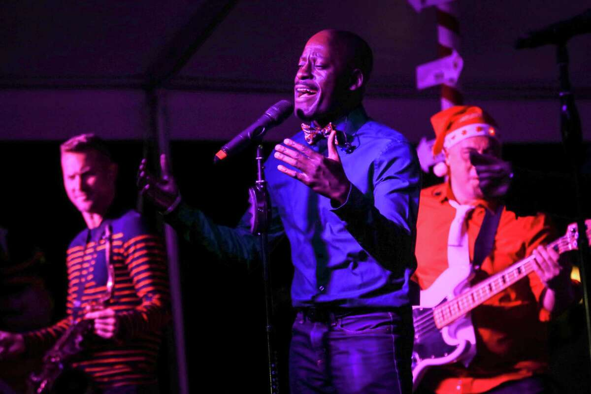 Uptown Drive performs during the Lighting of the Doves event on Saturday, Nov. 18, 2017, at Town Green Park.