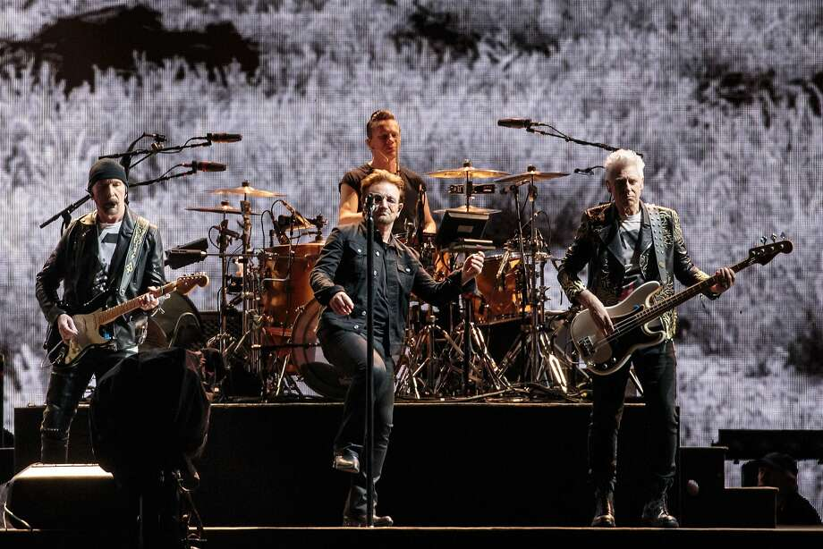 The Edge (left), drummer Larry Mullen Jr., Bono and Adam Clayton of U2 perform in Houston on the Joshua Tree Tour in May. Photo: SUZANNE CORDEIRO, AFP/Getty Images