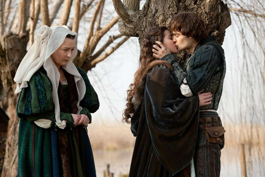 """This image released by Relativity Media shows Douglas Booth, right, and Hailee Steinfeld, center, in a scene from """"Romeo and Juliet."""" (AP Photo/Relativity Media, Philippe Antonello) Photo: Philippe Antonello, Associated Press"""
