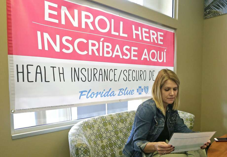 A woman reviews Affordable Care Act enrollment options this month in Hialeah, Fla. Photo: Alan Diaz, Associated Press