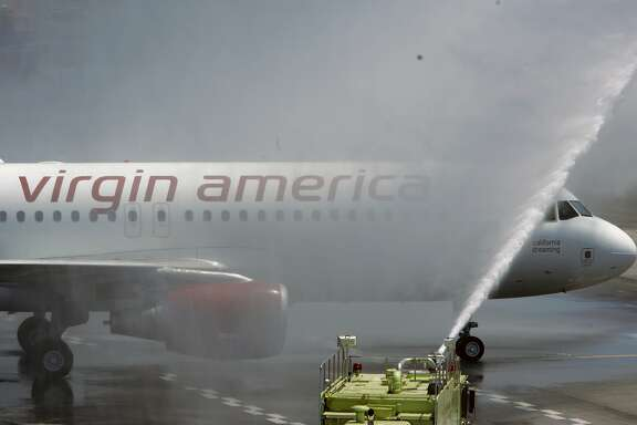 VIRGIN09_137_MBK.JPG Two Virgin America planes taxi to their terminal, under ceremonial water spray, where a reception party awaits passengers to mark the launch of the first flights by Virgin America, the new, based-in-San Francisco low fare airline created by Virgin's Richard Branson, at SFO in San Francisco, CA, on Wednesday, August, 8, 2007. photo taken: 8/8/07 Mike Kane / The Chronicle    *