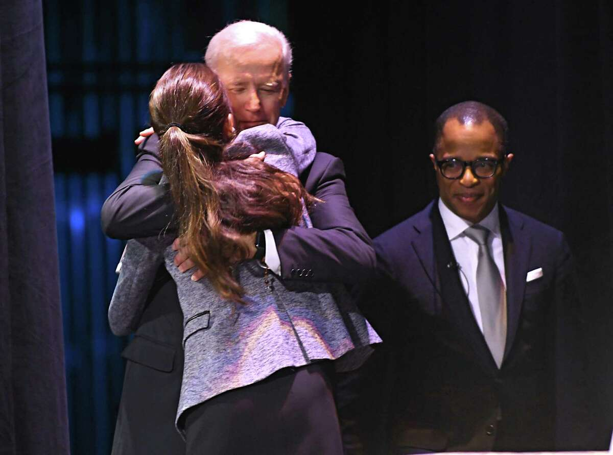 Former Vice President Joe Biden hugs his daughter Ashley Biden after she introduced him on stage at Proctors during his American Promise Tour on Monday, Nov. 20, 2017 in Schenectady, N.Y. Tickets to this event included a copy of Biden's memoir,