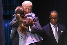 "Former Vice President Joe Biden hugs his daughter Ashley Biden after she introduced him on stage at Proctors during his American Promise Tour on Monday, Nov. 20, 2017 in Schenectady, N.Y. Tickets to this event included a copy of Biden's memoir, ""Promise Me, Dad: A Year of Hope, Hardship, and Purpose."" (Lori Van Buren / Times Union)"