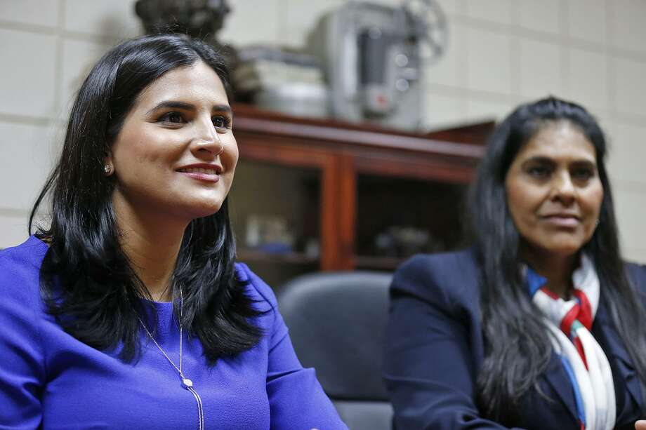 Veronica E. Bernal McCann (left) with her mother, Margarita Vega de Bernal, talk with Brownsville attorney Thomas Sullivan (not pictured) after Bernal McCann was sworn in as an attorney Monday. Sullivan was one of the attorneys that represented Bernal McCann's father, Efren C. Bernal, in the Supreme Court. Photo: Edward A. Ornelas /San Antonio Express-News / © 2017 San Antonio Express-News