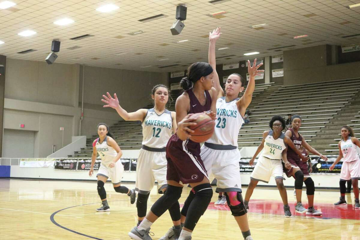Crystal Rodriguez (12) and McKenzie Cardenas (23) guard a Kempner ballhandler during second-half action at Phillips Field House Monday afternoon.