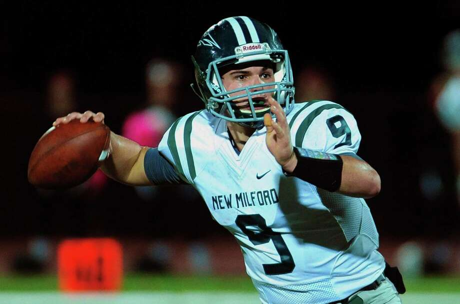 FILE PHOTO: New Milford's Tyler Sullivan prepares to throw a pass during football action against Masuk in Monroe Conn. on Friday Oct. 21, 2016. Photo: Christian Abraham / Hearst Connecticut Media / Connecticut Post