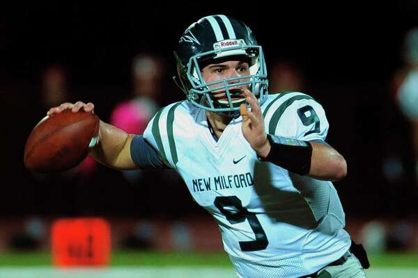 FILE PHOTO: New Milford's Tyler Sullivan prepares to throw a pass during football action against Masuk in Monroe Conn. on Friday Oct. 21, 2016.