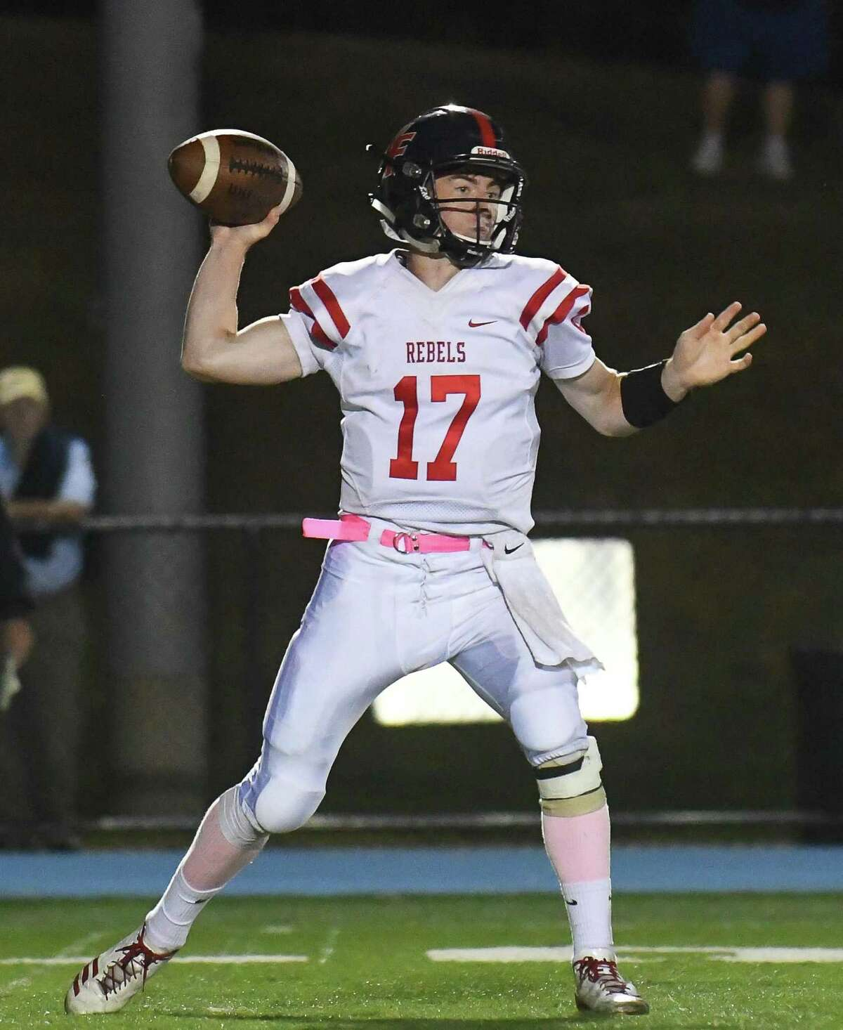 FILE PHOTO: William Enright (17) of the New Fairfield Rebels drops back to pass during a game against the Bunnell Bulldogs at Bunnell High School on Friday October 6, 2017 in Stratford, Connecticut.