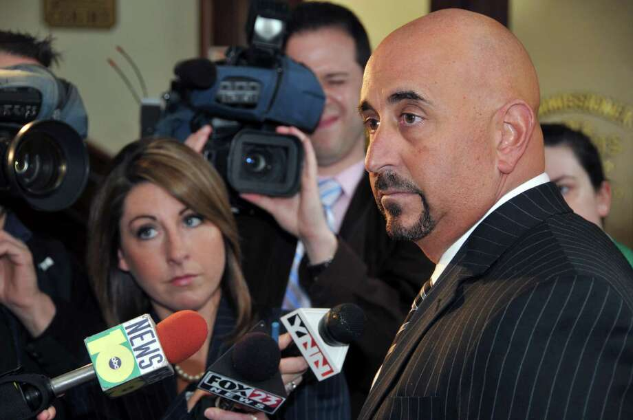 Gerard Amedio (at right) speaks to the media at  Saratoga Springs City Hall in 2010. The Republican is running against Karen Heggen for Saratoga County District Attorney. (John Carl D'Annibale / Times Union) Photo: John Carl D'Annibale