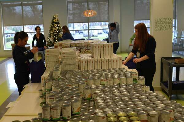 CAP COM Federal Credit Union and Hannaford Supermarkets are partnering to feed nearly 400 families this Thanksgiving. For the past five years Hannaford has supported the CAP COM Cares Foundation's Sharing the Harvest Thanksgiving program by donating all non-perishable food items including potatoes, stuffing, gravy, canned vegetables and more, as the foundation fundraises through the year to buy fresh turkeys, pies and bread from Hannaford to complete the meals.