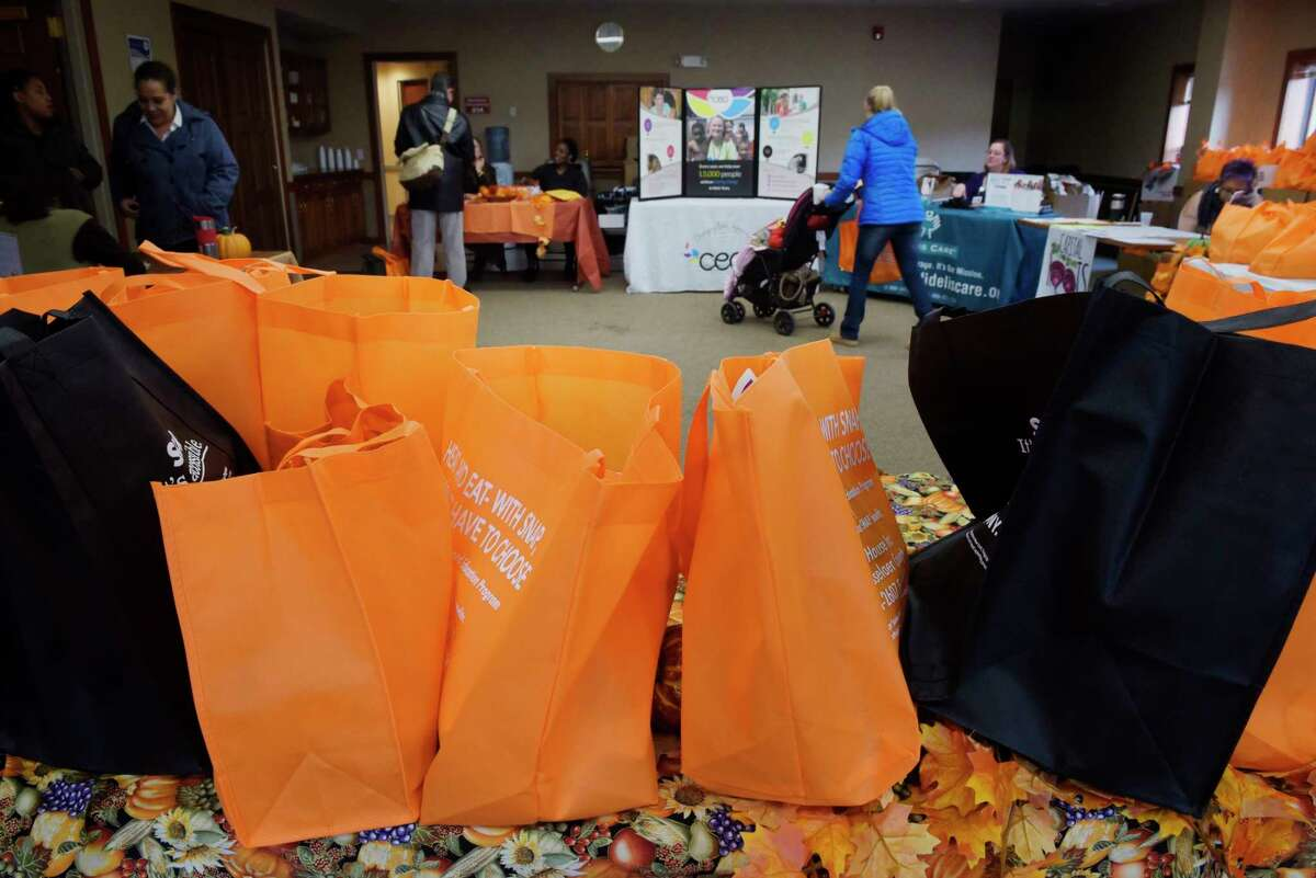 Bag containing food items are seen at the Thanksgiving Food Package Distribution put on by CEO, Unity House and Capital Roots on Monday, Nov. 20, 2017, in Troy, N.Y. The three local non-profits hold the yearly event to to get items out to 300 households so that they can prepare and serve a Thanksgiving meal to their family. (Paul Buckowski / Times Union)