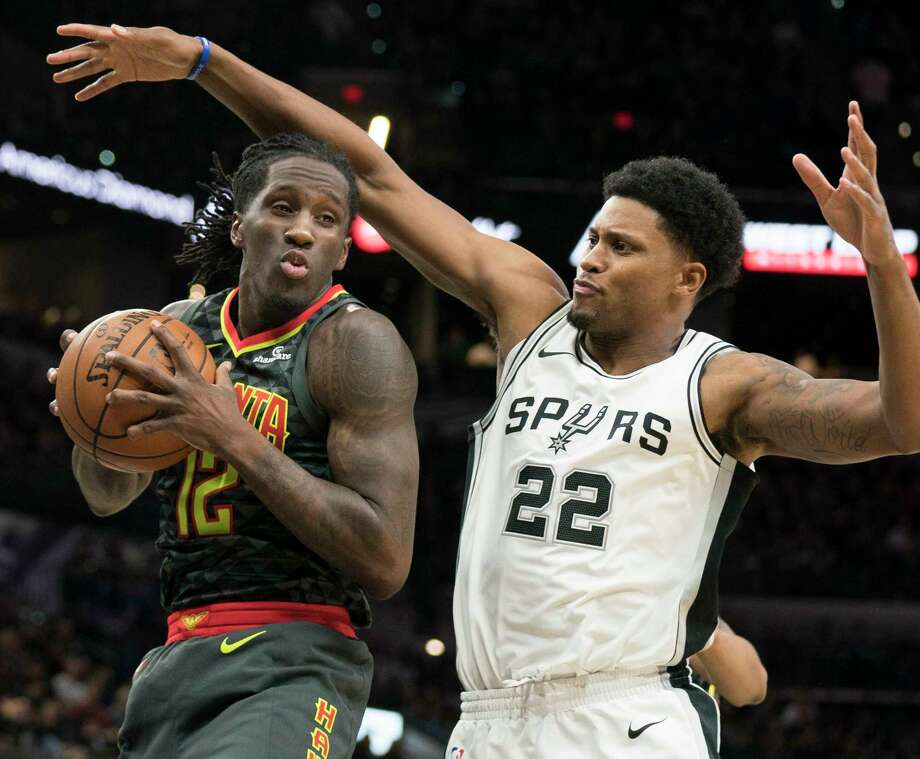 Atlanta Hawks forward Taurean Prince (12) looks to pass as he is guarded by San Antonio Spurs forward Rudy Gay during the first half of an NBA basketball game, Monday, Nov. 20, 2017, in San Antonio. (AP Photo/Darren Abate) Photo: Darren Abate, Associated Press / FR115 AP