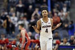 UConn's Jalen Adams will travel with UConn to the PK80 Invitational in Portland, Oregon.
