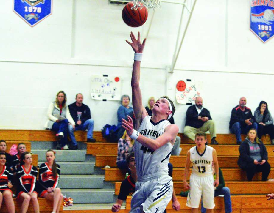 Father McGivney senior Logan Shumate goes up for a layup during the fourth quarter of Monday's game against Ramsey at the Mulberry Grove Turkey Tournament.