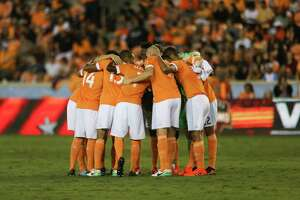 Houston Dynamo huddle before taking on Sporting Kansas City for the first-round playoff MLS match at BBVA Compass Stadium Thursday, Oct. 26, 2017, in Houston. ( Yi-Chin Lee / Houston Chronicle )