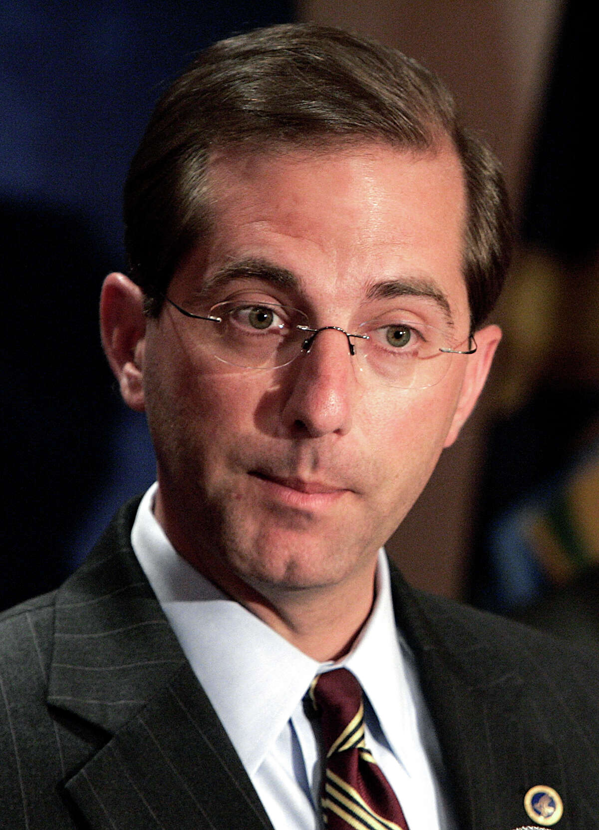 FILE - In this April 25, 2006 file photo, Alex Azar, then U.S. Department of Health and Human Services Deputy Secretary, speaks at a state of Michigan pandemic influenza summit in Detroit. Newly disclosed financial records show that Azar, President Donald TrumpÂ?'s nominee to become secretary for the Health and Human Services Department, reaped big earnings during his tenure as a top pharmaceutical executive. (AP Photo/Paul Sancya)
